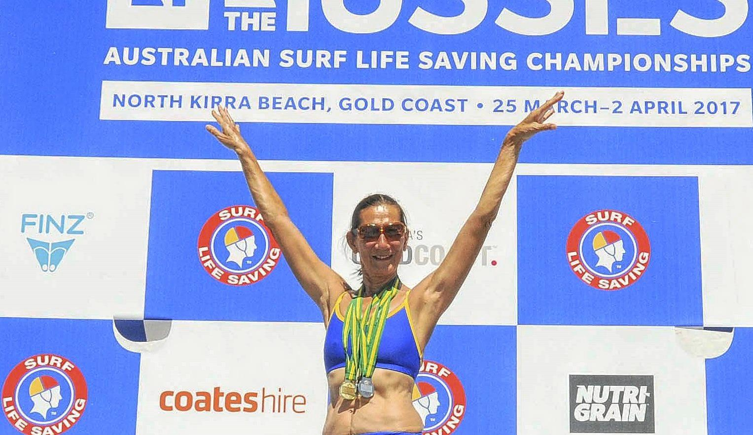 CHAMPION: Mei-Ling Venning celebrates her medals at the Australian Masters Surf Lifesaving Championships on the Gold Coast.