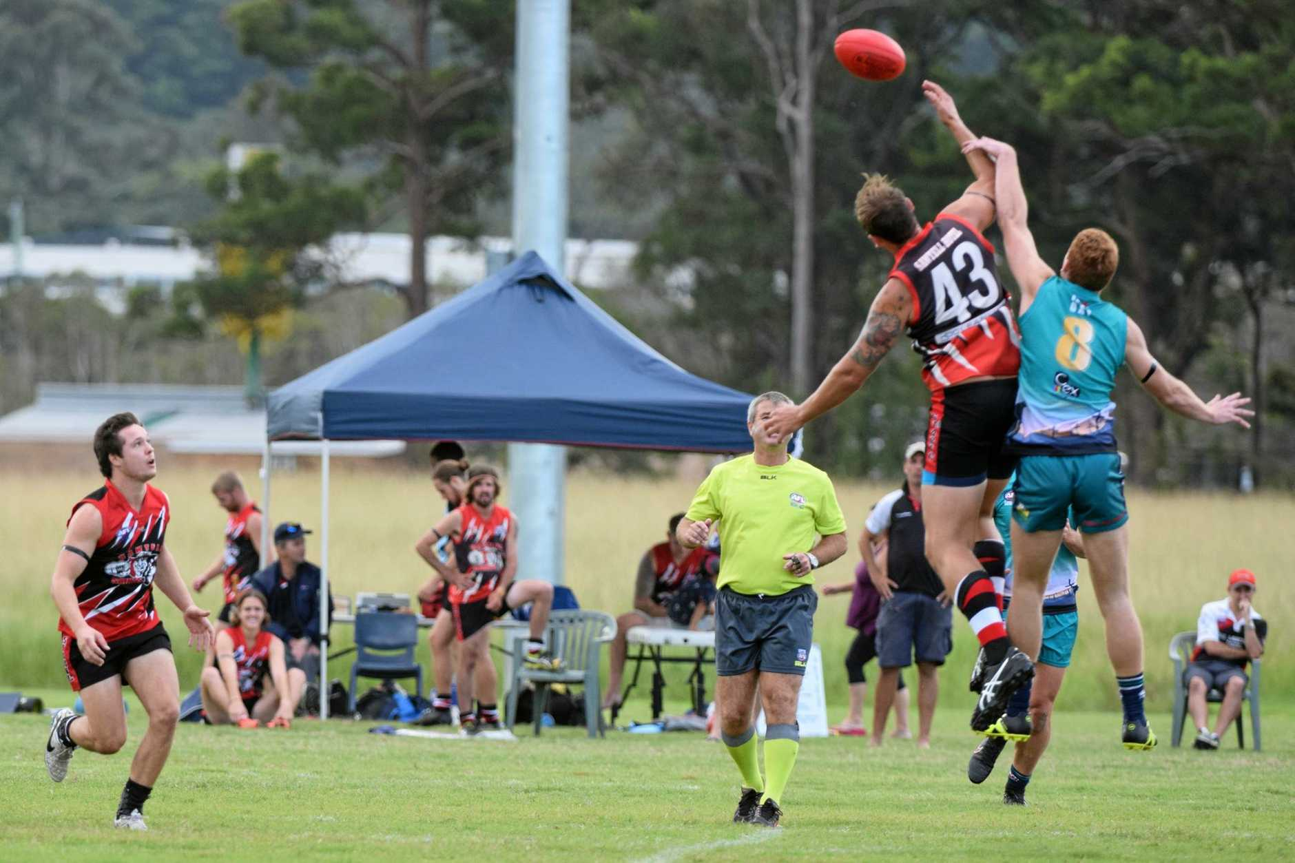 Hamish Bird from the Sawtell/Toormina Saints is about to run on to a hitout from teammate Bradley Collon against the Coffs Breakers. AFL North Coast 22 April 2017 Coffs Coast Sport and Leisure Park Photo: Brad Greenshields/Coffs Coast Advocate