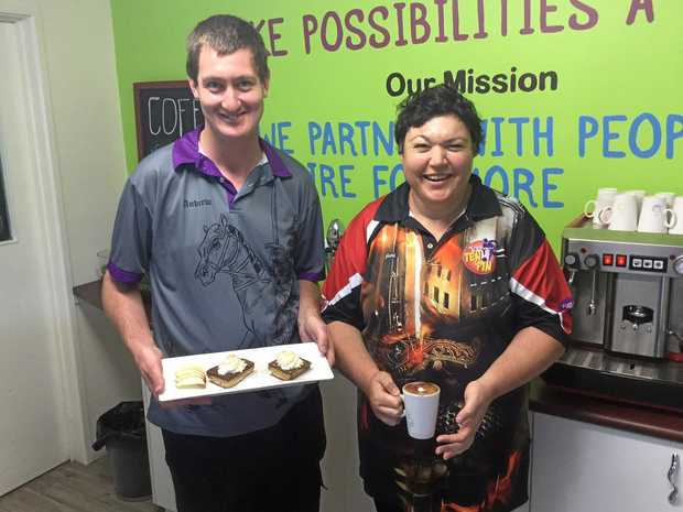 LEARNING AND GROWING THROUGH COOKING: Andy Simmons and Beth Fulton in Endeavour Foundation's famous Kingaroy Kitchen.