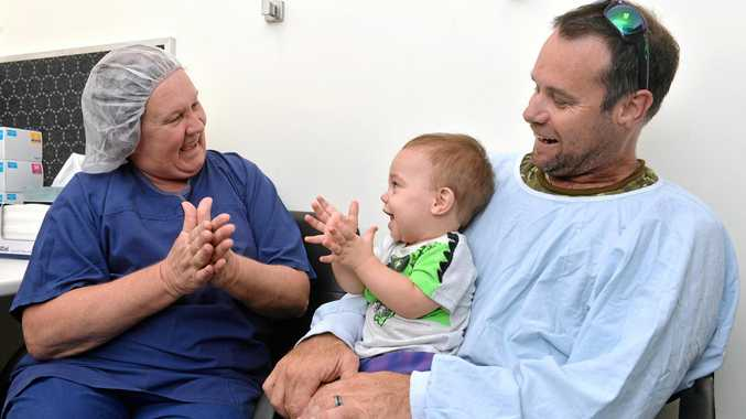 Yahn Verburg and his son Linken talk with Adrianna Adam, nurse unit manager of the Mater operating theatre, just before Linken's operation.