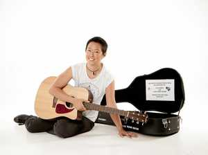 Girl with a car and guitar to perform in Noosa