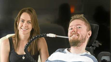 BID FOR FREEDOM: Mitchell Fletcher with one of his carers Danielle Walker.