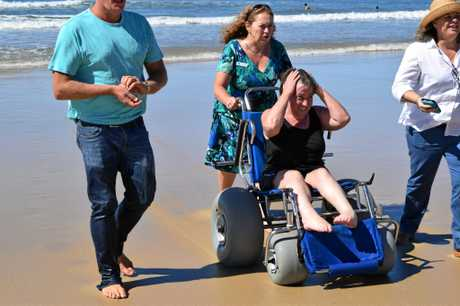 STOKED: Tania Sherley was ecstatic to use the disability access beach mat at Alexandra Headland.