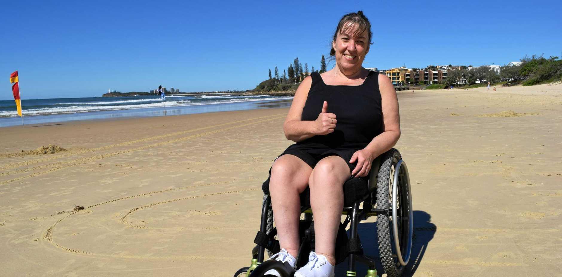 STOKED: Tania Sherley was ecstatic to use the disability access beach mat at Alexandra Headland.
