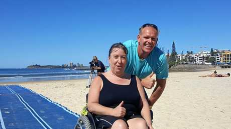 STOKED: Tania Sherley and Cr Jason O'Pray at the new disability beach access mat.