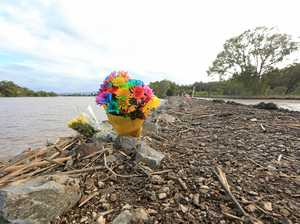 SAFETY QUESTIONS: Flowers are left at the scene of the accident on Dulguigan Rd.