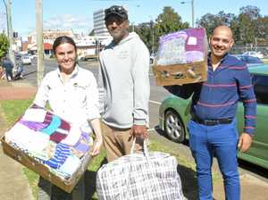 CHARITABLE HEARTS: Collecting donations from PEACE group are (from left) Tiffany Spary from Base Services and Adam Wenitong from Young Bruthas with PEACE volunteer delivery driver Mustafa Allami.