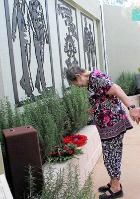 Cooinda resident Gloria Parker, who had five uncles who served for Australia, laying a wreath at the new memorial on behalf of Cooindas Zane Lodge.