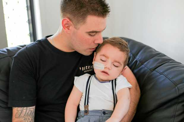 James Flaskas, 27, with his little boy Tyler Flaskas, 20 months old. The Mackay toddler suffers from a rare mitochondrial condition, thought to be Leigh's Syndrome.