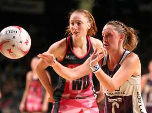 Erin Burger (right) of the Firebirds passes the ball against the Thunderbirds.