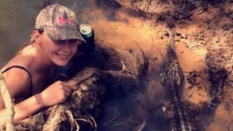 Innisfail woman Shae Pasetti with the small crocodile.