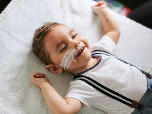 Brave little boy still manages to laugh