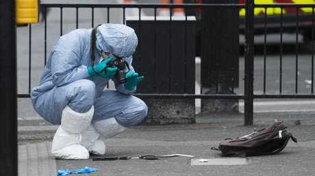 Forensic Officers examine items left on the pavement after police lead away a man following an incident in Whitehall, Westminster, Central London, Britain, 27 April 2017. Reports have suggested a man was arrested carrying knifes.