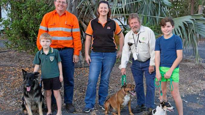RIGHT DECISION: Pete Stoneman, his sons and their three dogs, CQ Pet Rescue president Susan Consedine and council ranger John Sykes.