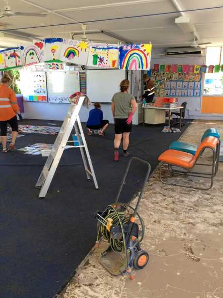 The damage to Homebush State School was quickly cleaned up by community members.