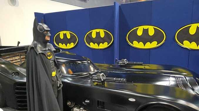 ON DISPLAY: Cameron Blackburn dresses at Batman while he poses with his Batmobile at the Supanova Pop Culture Expo.