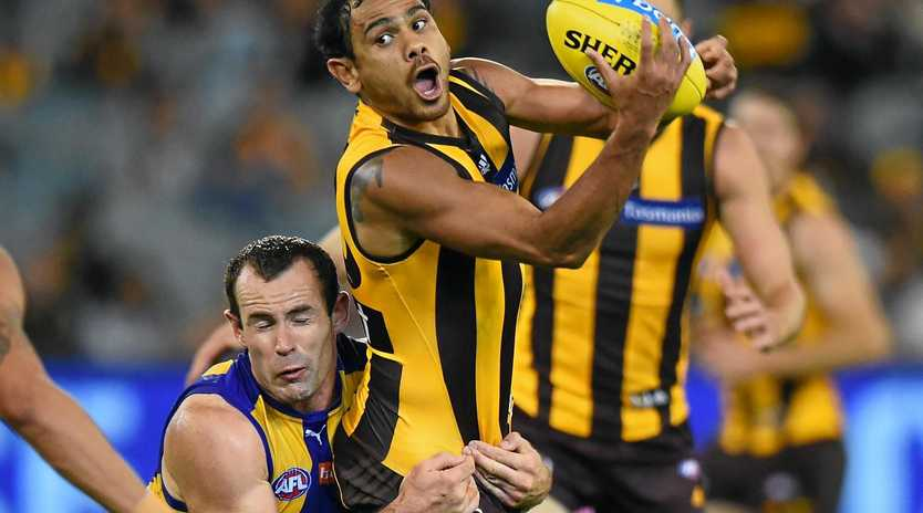 Hawthorn's Cyril Rioli under pressure from Shannon Hurn of the Eagles.