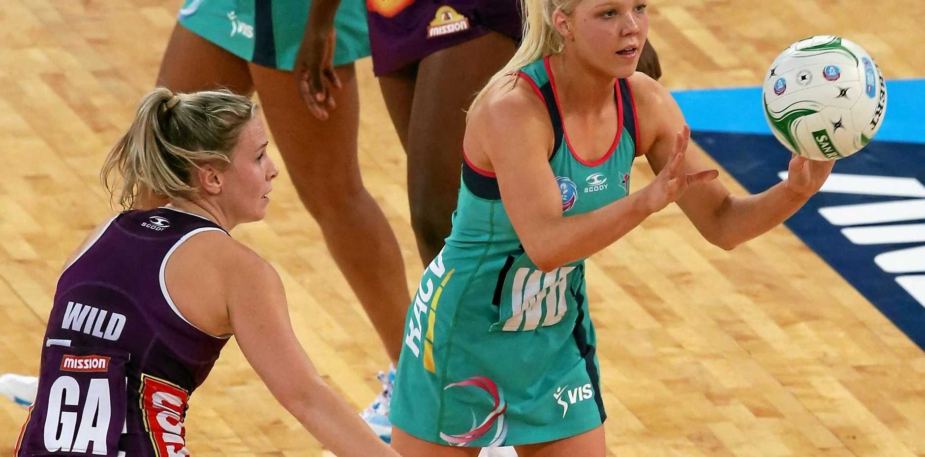 REVENGE: Melbourne Vixens captain Kate Moloney (passing the ball).