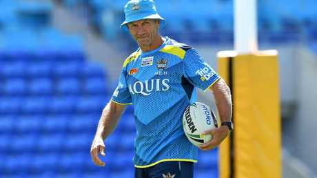 Coach Neil Henry looks on during a Gold Coast Titans training session at Cbus Super Stadium.