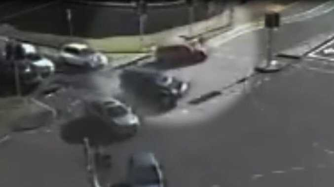 Police are looking for a driver who allegedly drove off after hitting a little boy crossing the Road at Benowa yesterday. In this CCTV image, the hatchback can be seen striking the child. Picture: Courtesy of the Queensland Police Service.