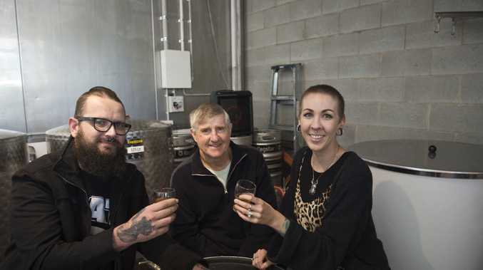 Loving the beer are (from left) Michael Mayhead, Bob Wylie and Amy Wylie as 4 Brothers Brewing opens, Saturday, April 29, 2017.