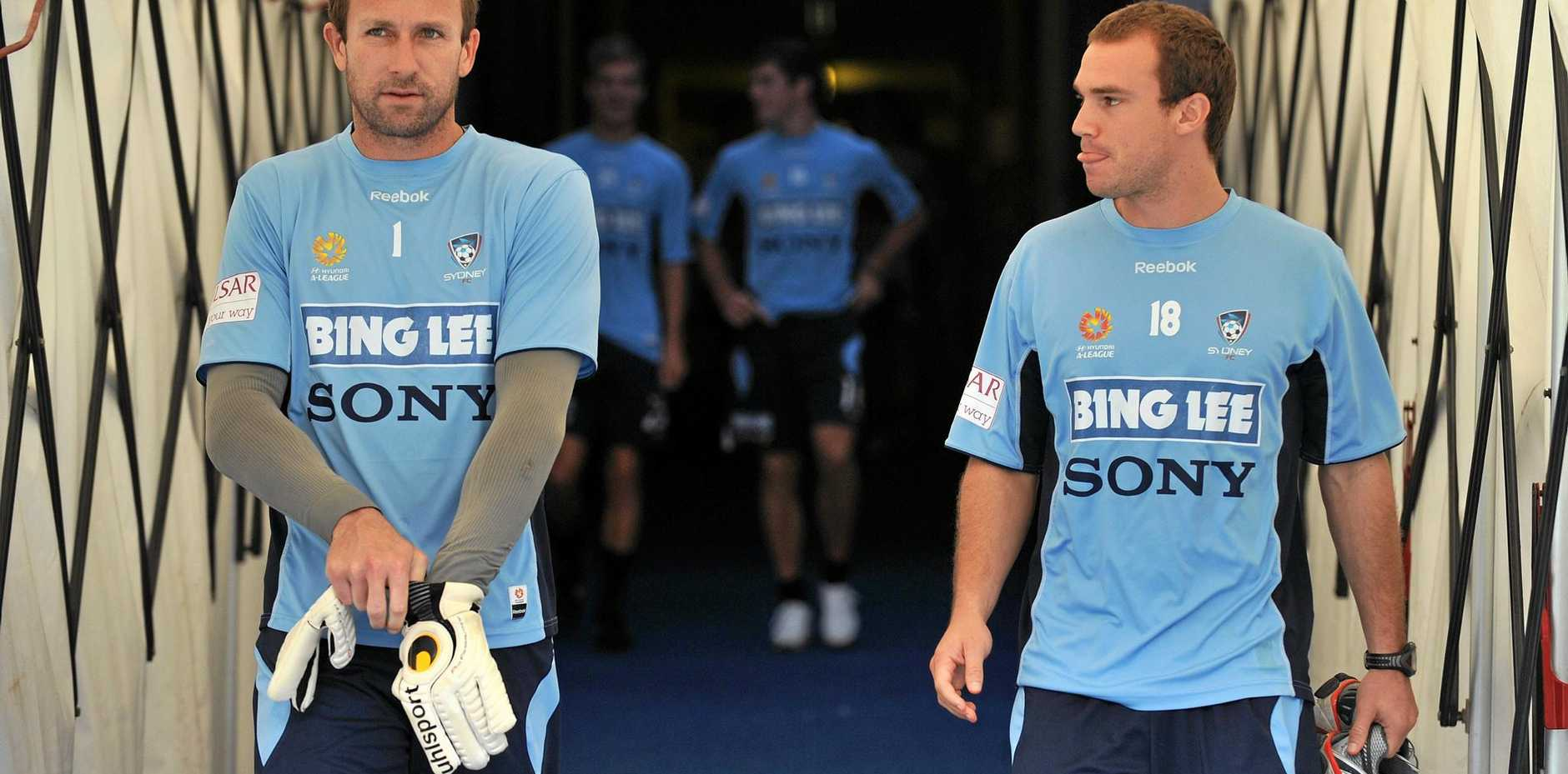 CHAMPION: Bundaberg's Clint Bolton (left) in acton for Sydney FC offers advice to Josh Brillante before the finals.
