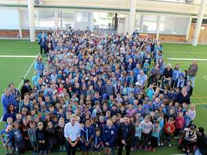 GREAT EFFORT: DSS teacher Brigid Prow, school captain Mitchell Sternes, year one student Charlie Morris, school captain Matilda Salter, and deputy principal Ben Edmunds in front of Dalby South's sea of blue.