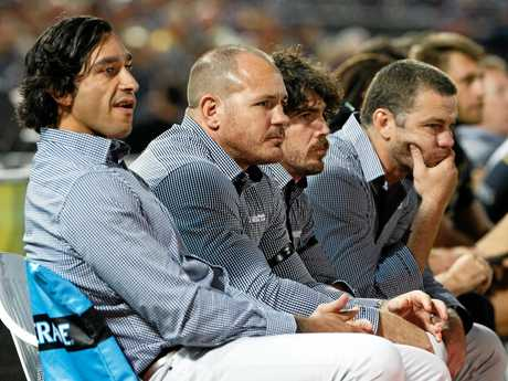 Out-of-action Cowboys co-captains Johnathan Thurston and Matthew Scott watch the game against the Eels.