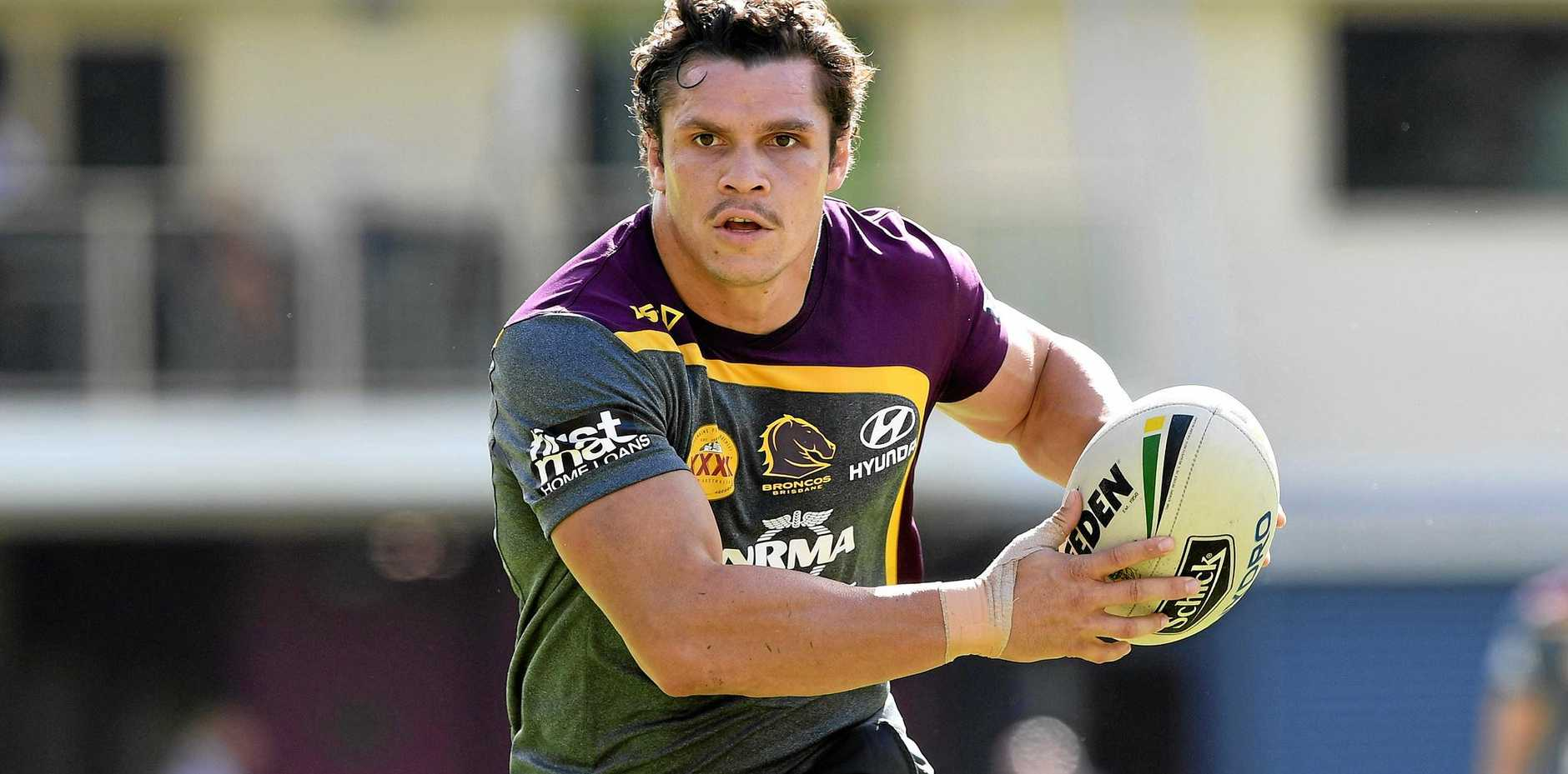 Brisbane Broncos player James Roberts runs with the ball during a training session at Red Hill.