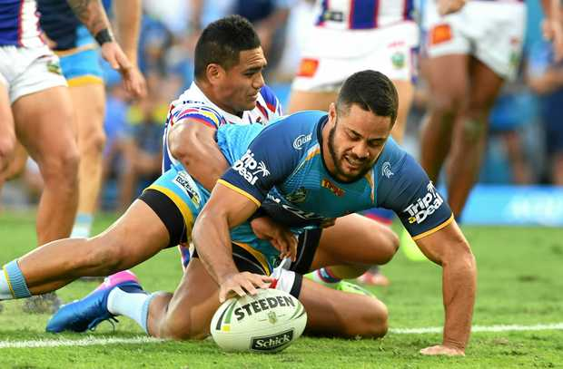 Titans player Jarryd Hayne scores a try against the Knights.