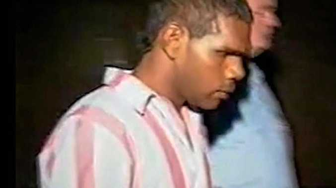 Kevin Henry being led away by guards during his 1992 murder trial.