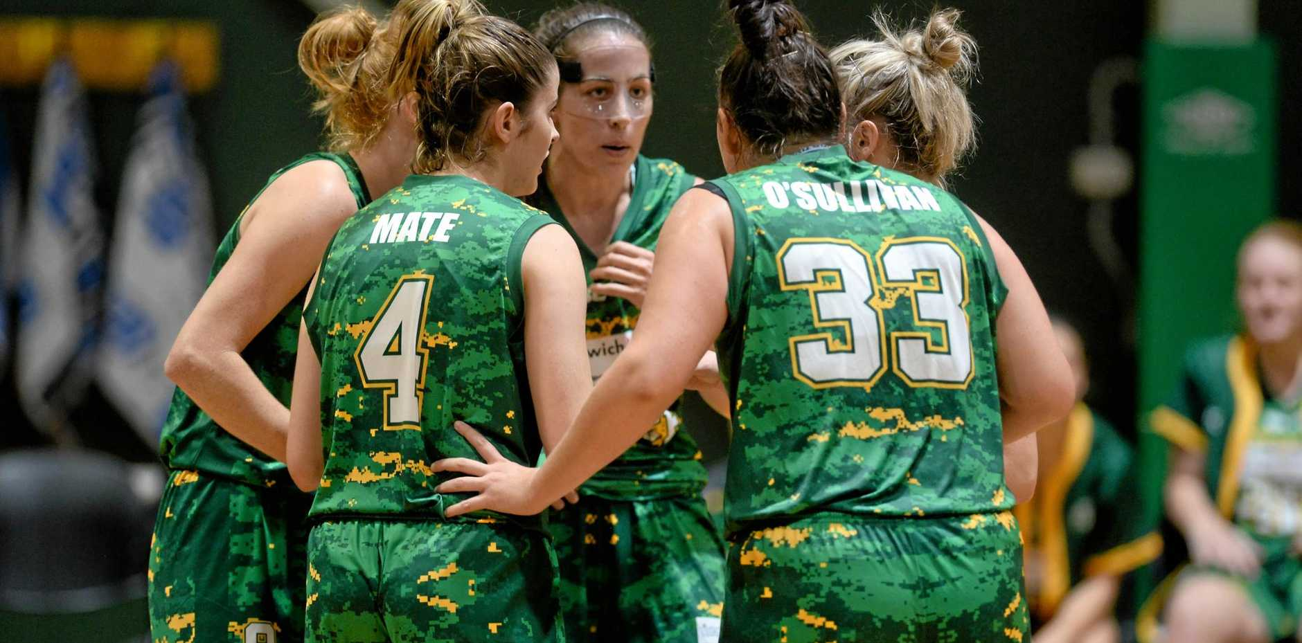 Force co-captain Bree Farley (middle) keeps her teammates focused during Ipswich's comprehensive victory over Toowoomba on Saturday night.