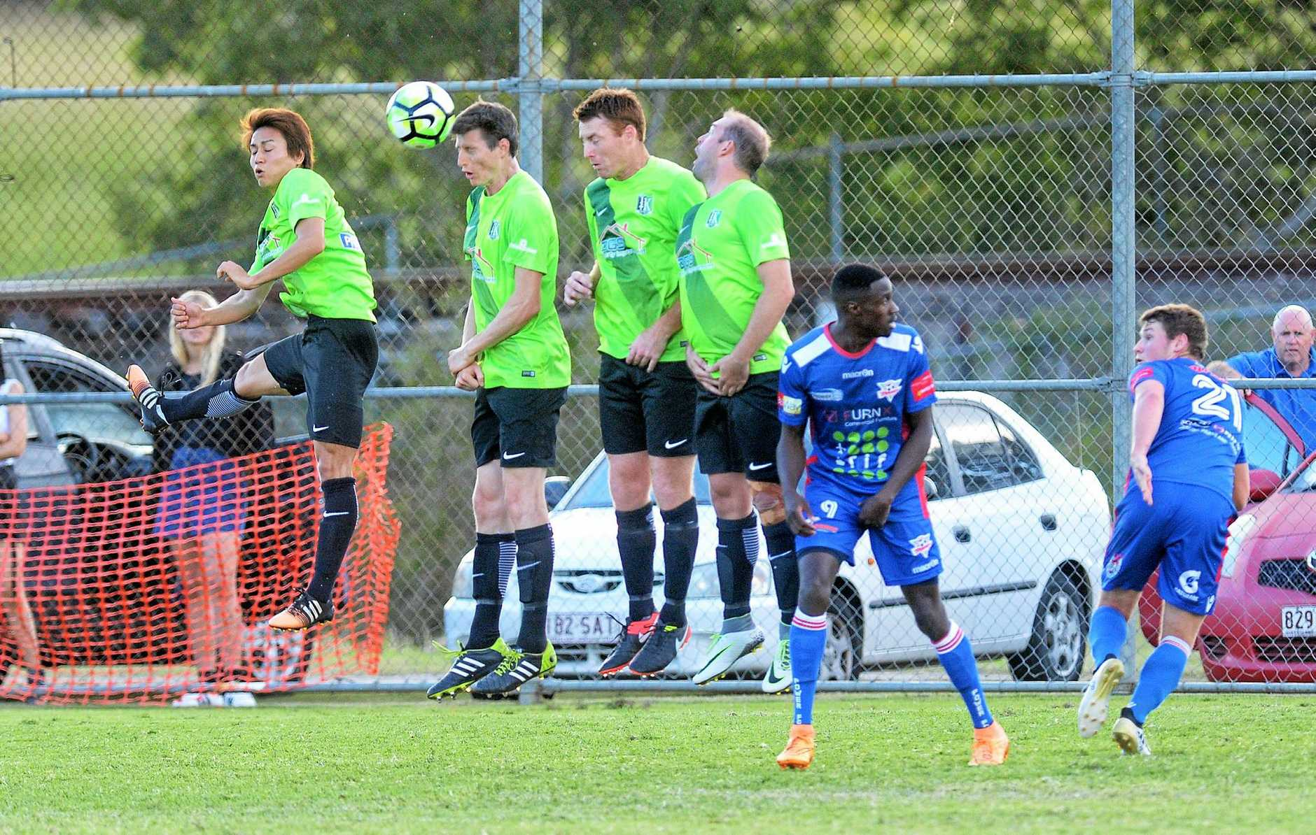 The Ipswich Knights defence rises as one to block a free kick during today's Brisbane Premier League match against Peninsula Power at Bundamba.