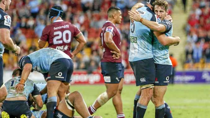 Waratah players celebrate after their win during the Round 10 Super Rugby match between the Queensland Reds and the NSW Waratahs at Suncorp Stadium.
