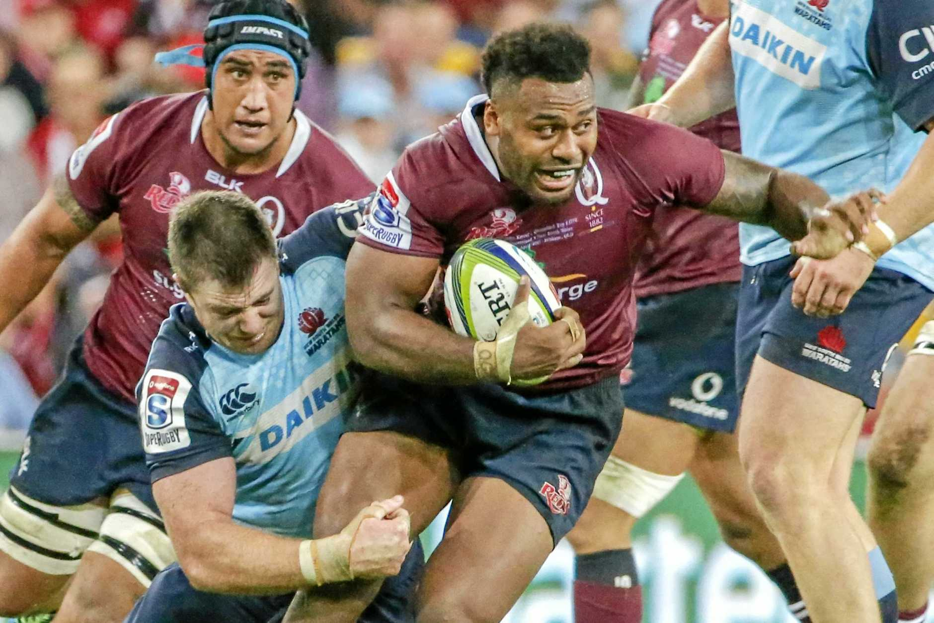 Samu Kerevi (right) of the Reds is tackled by Jed Holloway of the Waratahs.