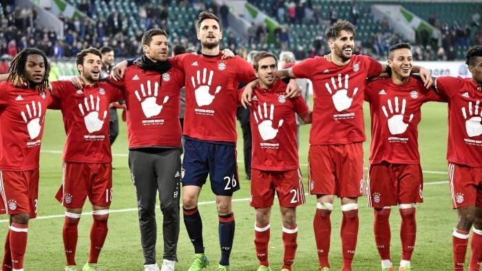 Bayern Munich players celebrate winning the Bundesliga.