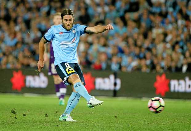 Sydney's Josh Brillante shoots and scores the first goal during the A-League semi-final win over Perth.