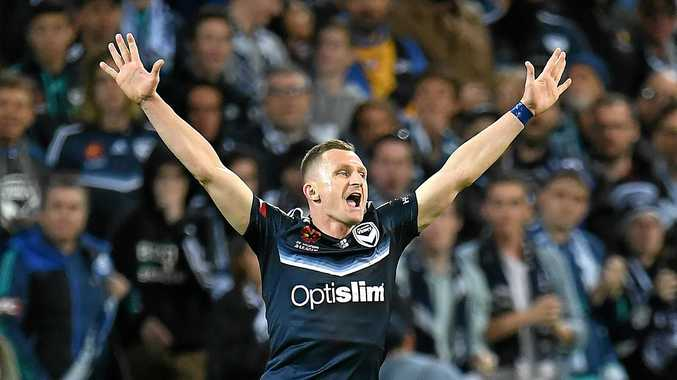 Besart Berisha of Victory reacts on the final whistle after defeating Brisbane Roar in the A-League semi-final.