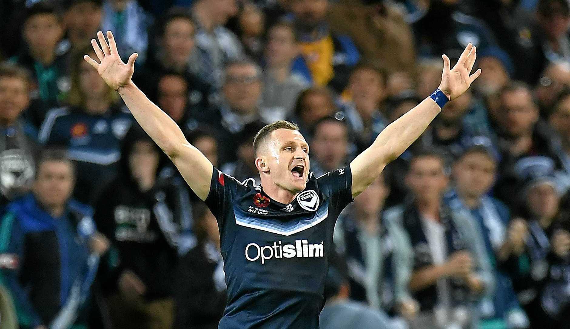 Besart Berisha celebrates reaching the A-League grand final aftera 1-0 win over Brisbane Roar.