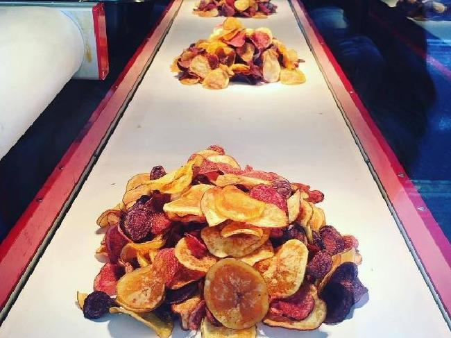 These chips are served on a conveyor belt.