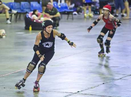 Take mum to see some roller derby action this Mother's Day. Pictured is Lou Sykes AKA Skatt-her Brains during last year's BruiseFest.