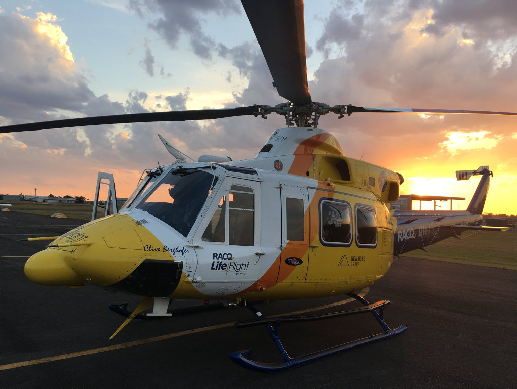 A four-and-a-half month old was airlifted to Brisbane after falling into a fire at Inskip Point.