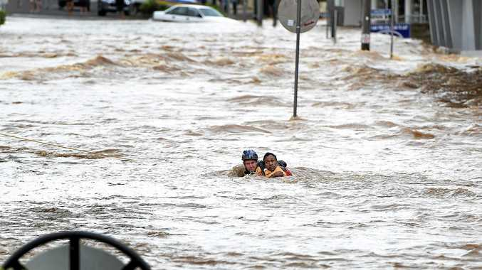 Emergency Service rescue a man from the centre of town after heavy flooding in town.