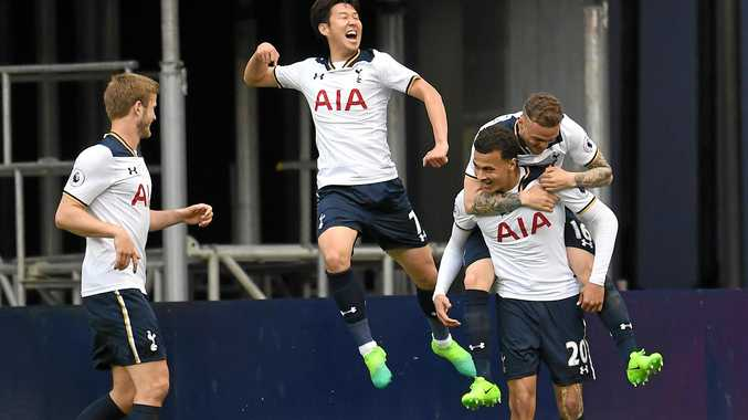 Tottenham players celebrate with teammate Dele Alli (second right) after he scored in the win over Arsenal.