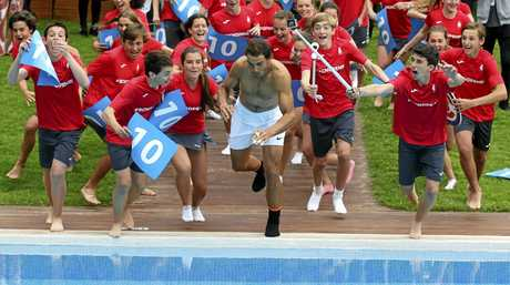 Nadal  jumps into a swimming pool after winning his men's finals match