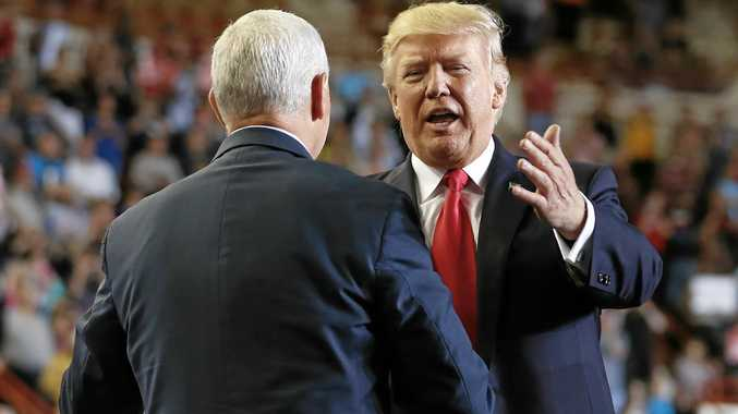 100 DAYS: President Donald Trump is greeted by Vice-President Mike Pence as he arrives to speak at the Pennsylvania Farm Show Complex and Expo Center on the weekend.
