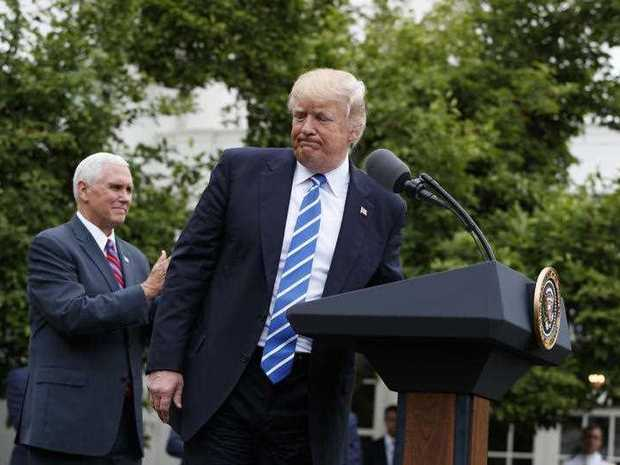 Vice President Mike Pence applauds as President Donald Trump walks off after speaking to the Independent Community Bankers Association, Monday, May 1, 2017, in the Kennedy Garden of the White House in Washington.