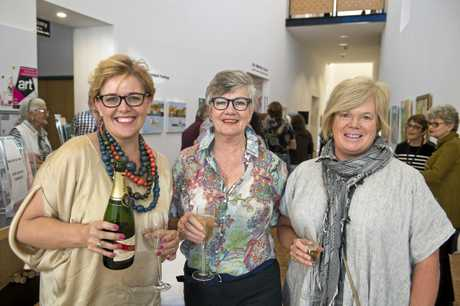 Celebrating the release of the book and the opening of the exhibition are (from left) Shana Rogers, Rosemarie Dawes and Lisa Matthews.