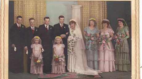 The Simmons wedding party (from left) Douglas Simmons, Len Sizer, Keith Simmons,  Alex Simmons, Val Sizer, Sylvia Hammond, Sylvia Byers, Elizabeth Lebsanft (nee Simmons) and flower girls Kaye Missen and Pam Schultz.
