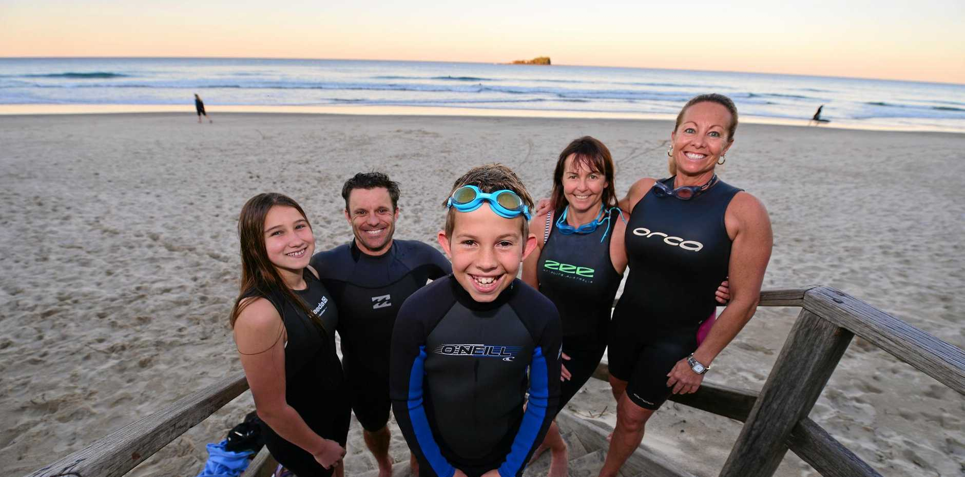 COMMITTED: Turtles team members line up for the 2015 Island Charity Swim: Nathan Jonns (front) with (from left) Dali Baldock, Todd McSwan, Andrea Fesselet and Kim Hatton.